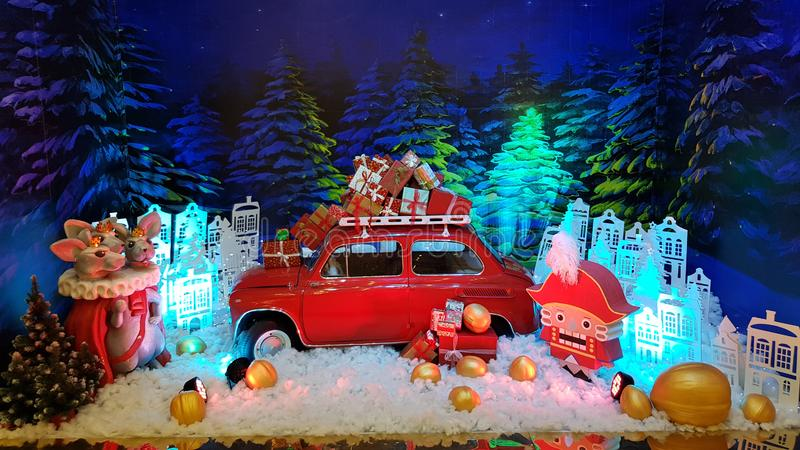 Diorama decorations of Christmas fairy tale Nutcracker with mini red car retro style in center. Winter holiday story backdrop. royalty free stock photography