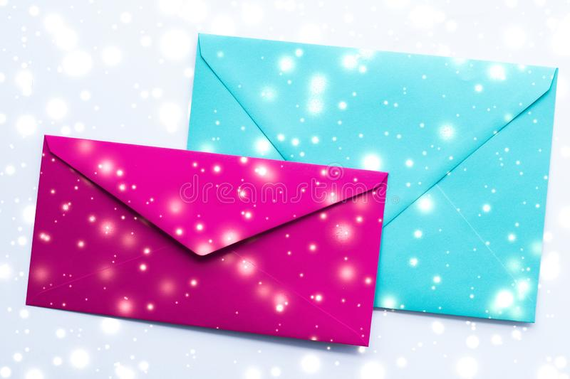Winter holiday blank paper envelopes on marble with shiny snow flatlay background, love letter or Christmas mail card design. Greetings, postal service and stock illustration
