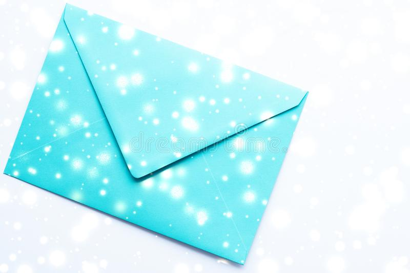 Winter holiday blank paper envelopes on marble with shiny snow flatlay background, love letter or Christmas mail card design stock photos