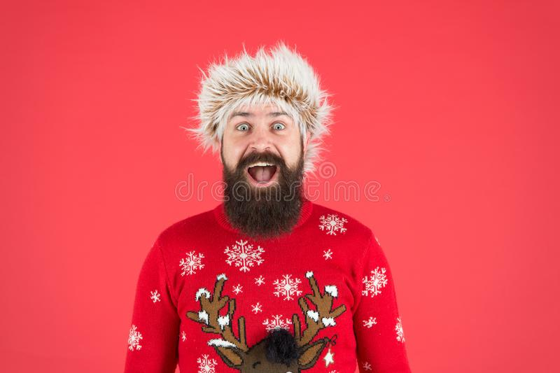 Winter holiday celebration. cold weather fashion for men. happy new year. bearded man smiling on red background. funny stock photography