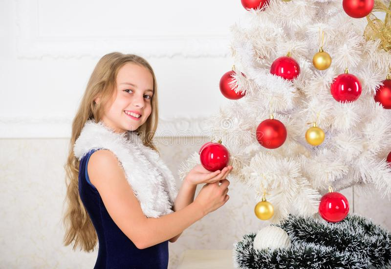 Winter holiday concept. Family holiday concept. Girl velvet dress feel festive near christmas tree. Very special time of royalty free stock photography