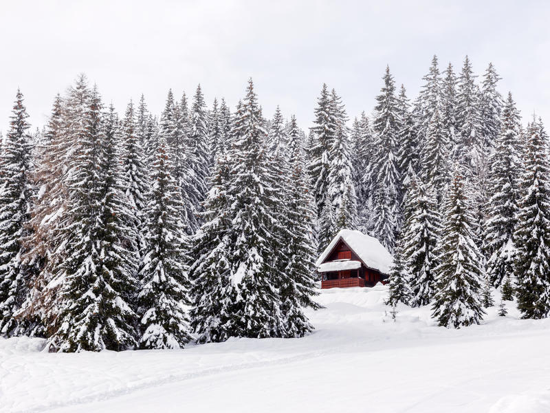 Winter holiday house in slovenia alps royalty free stock photography