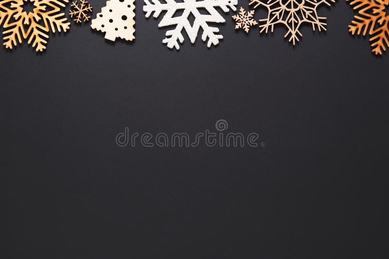Winter holidays background with handmade wooden elements. Flat lay Christmas background.Handmade New Year decorations on black poster with empty space for text royalty free stock photos