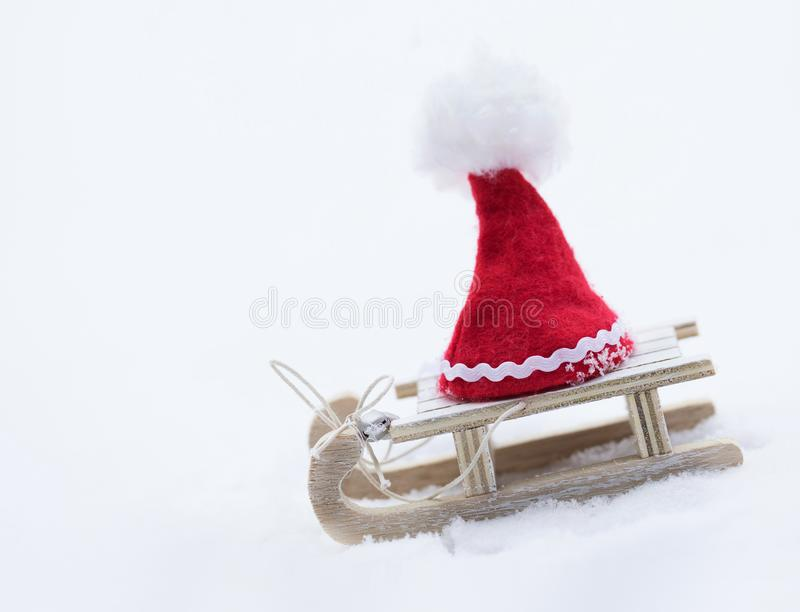 Santa Claus hat on a wooden made sleigh. stock image