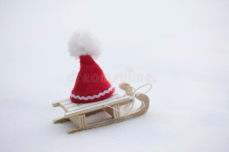 Santa Claus hat on a wooden made sleigh. royalty free stock image