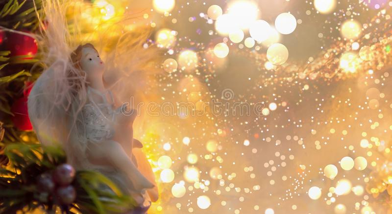 Winter holidays banner with angel figurine royalty free stock photo
