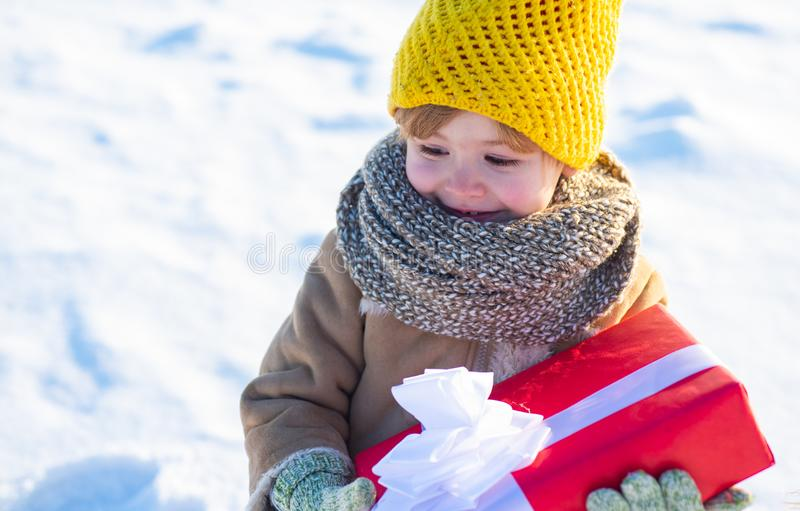 Winter holidays concept. May you have wonderful holiday. Happy new year and merry christmas. Happy winter child hold royalty free stock images