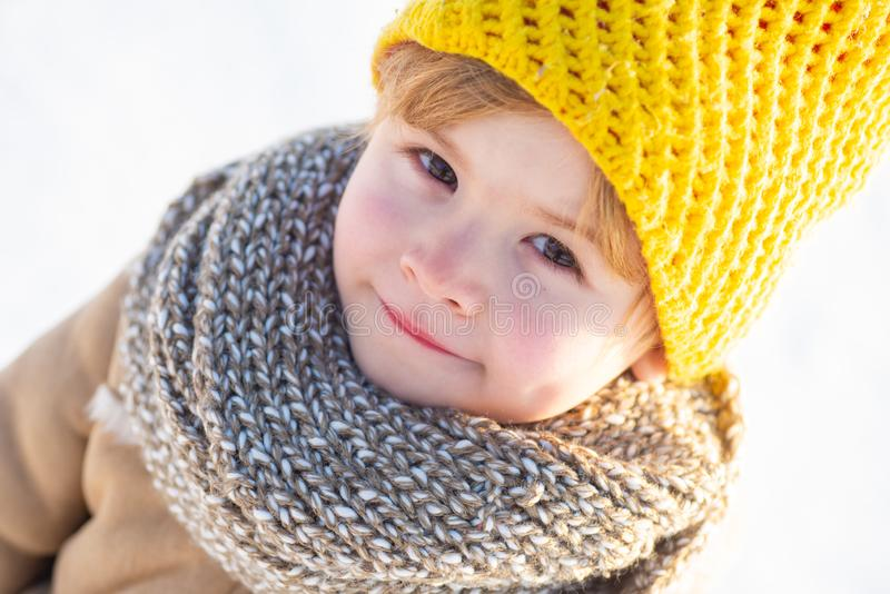 Winter holidays concept. May you have wonderful holiday. Happy new year and merry christmas. Happy winter child snow. Background. Cute boy in winter clothes hat royalty free stock photography