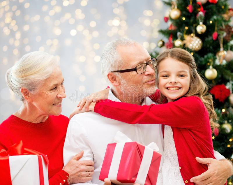 Happy family with christmas gifts over lights stock photography