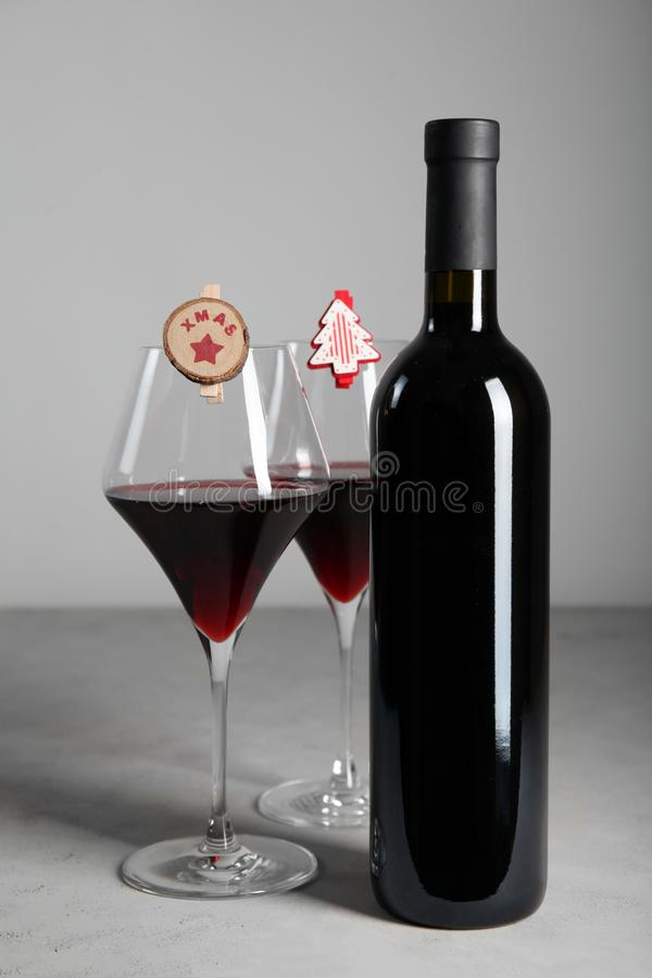 Winter holidays with a glass of red wine, Christmas decorations and decor royalty free stock photo