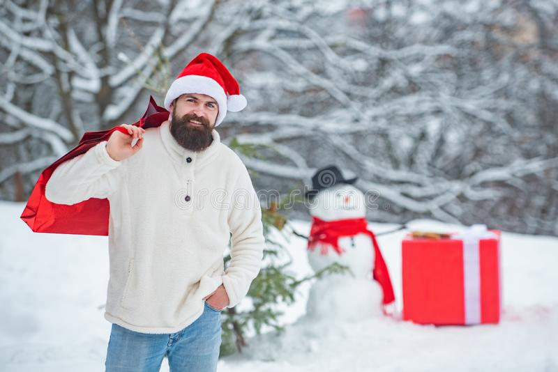 Winter holidays and people concept. Christmas shopping with shopping bag. Enjoying nature wintertime. Christmas sale and stock images