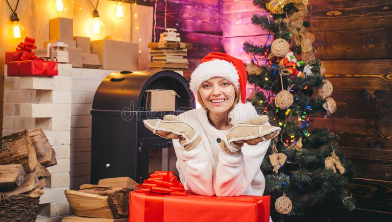 Winter holidays and people concept. Merry Christmas and Happy New Year. Elegant lady over Christmas tree lights. Background royalty free stock image
