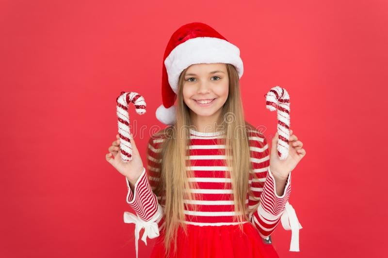 Winter holidays. Playful mood. Christmas celebration ideas. Shine and glitter. Child Santa Claus costume hat. Happy. Smiling face. Beautiful detail. Positivity stock images