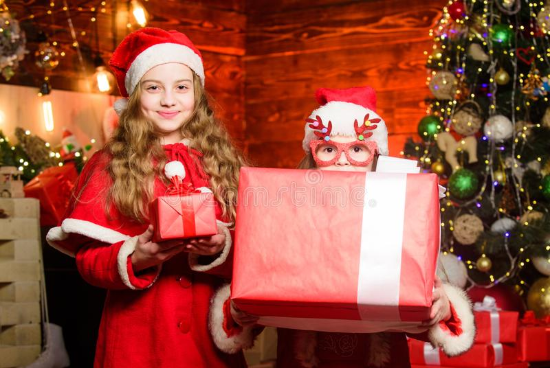 Winter holidays sales. small girl kids in red santa hat. wait for xmas gift. christmas time. Love winter holidays royalty free stock images