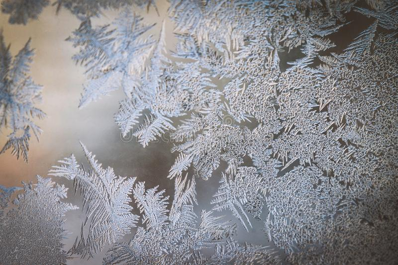 Winter Holidays Season Fantasy World Concept: Colorful Macro Image Of A Frosty Window Glass Natural Ice Patterns With Copy Space stock photo