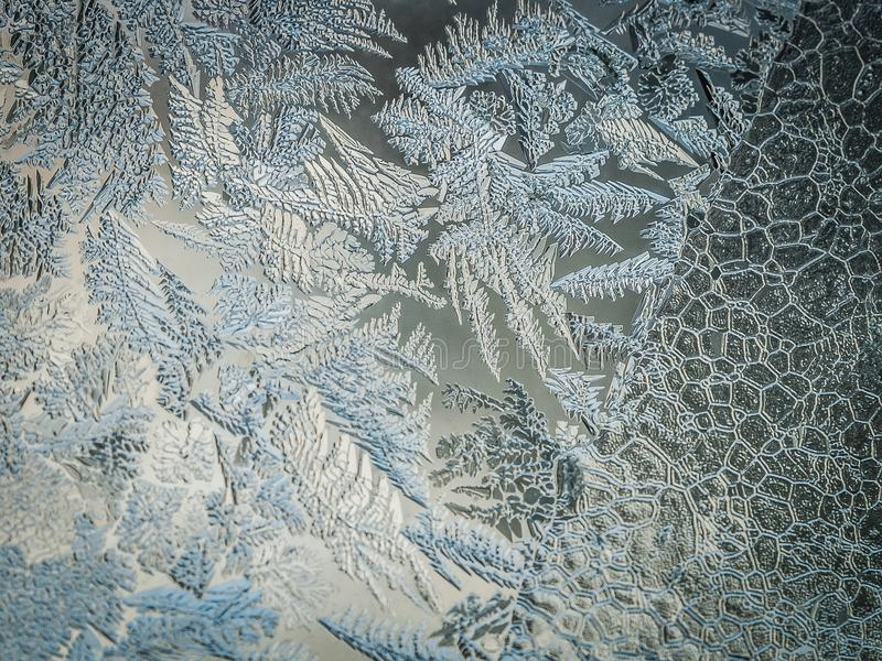 Winter Holidays Season Fantasy World Concept: Macro Image Of A Frosty Window Glass Natural Ice Patterns With Copy Space royalty free stock photo