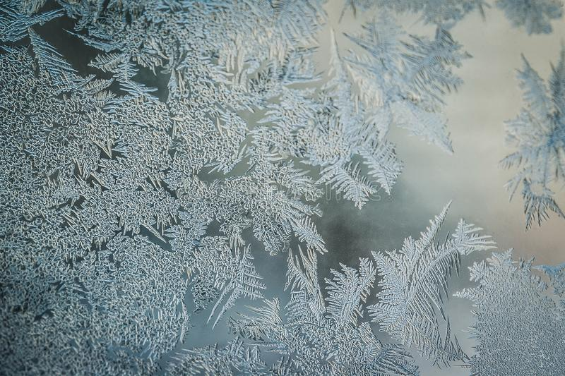 Winter Holidays Season Fantasy World Concept: Macro Image Of A Frosty Window Glass Natural Ice Patterns With Copy Space royalty free stock photos
