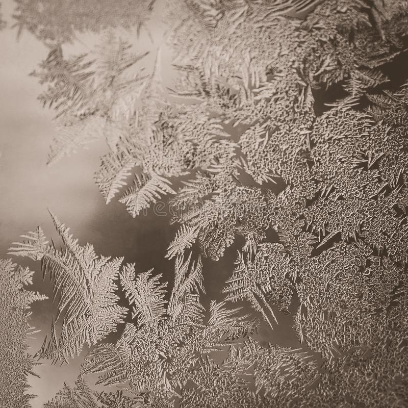 Winter Holidays Season Fantasy World Concept: Vintage Macro Image Of A Frosty Window Glass Natural Ice Patterns With Copy Space stock photo