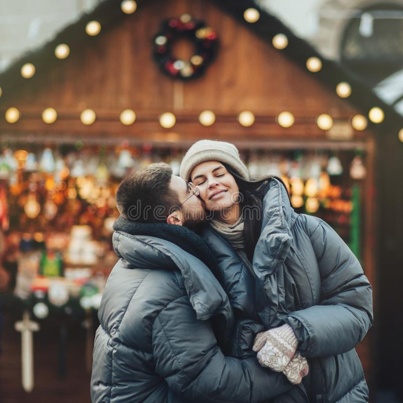 Winter holidays. Young beautiful happy smiling couple posing on royalty free stock photos