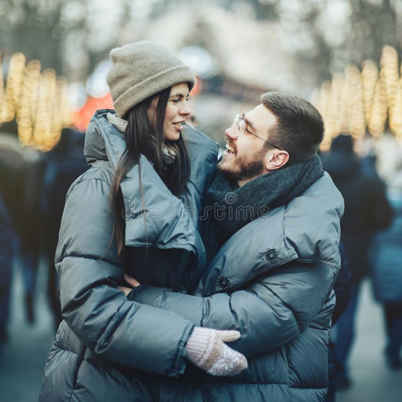 Winter holidays. Young beautiful happy smiling couple posing on royalty free stock photo