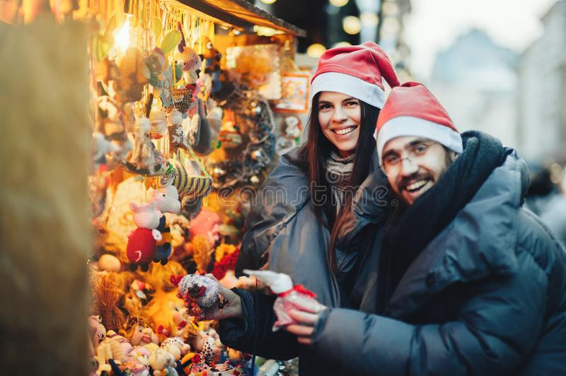 Winter holidays. Young beautiful happy smiling couple posing on stock image