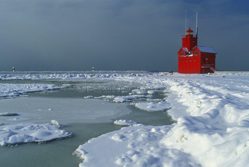 Winter, Holland Lighthouse. Lake Michigan winter shoreline and Holland Lighthouse, Michigan, USA stock image