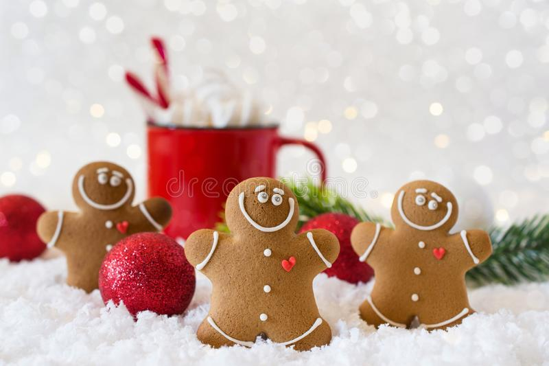 Winter hot drink, cacao with marshmallows and gingerbread man cookies, spicy hot chocolate festive background stock image