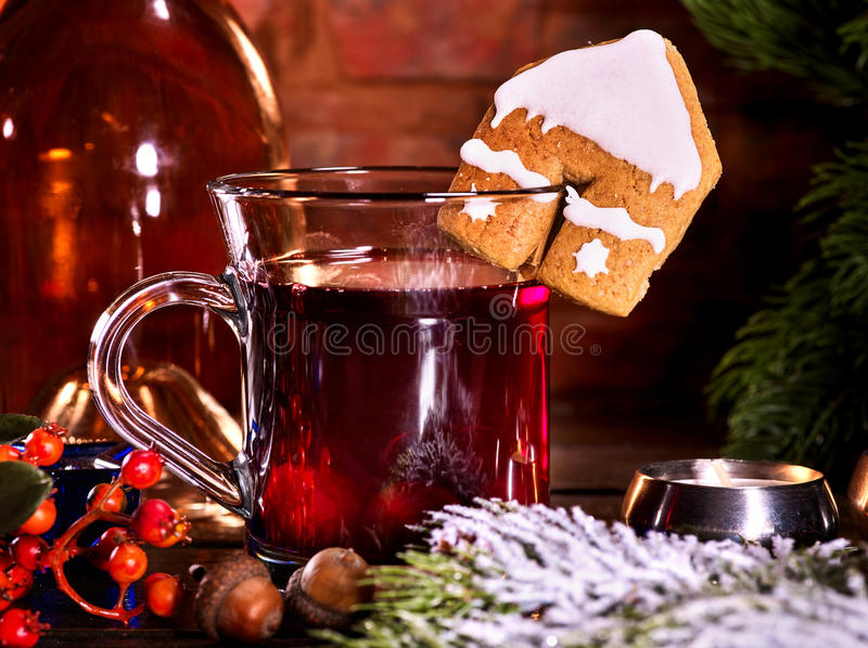 Winter hot drink with cookie and berry. Still life of winter hot drink. Warming mulled wine with cookie in form of house royalty free stock images