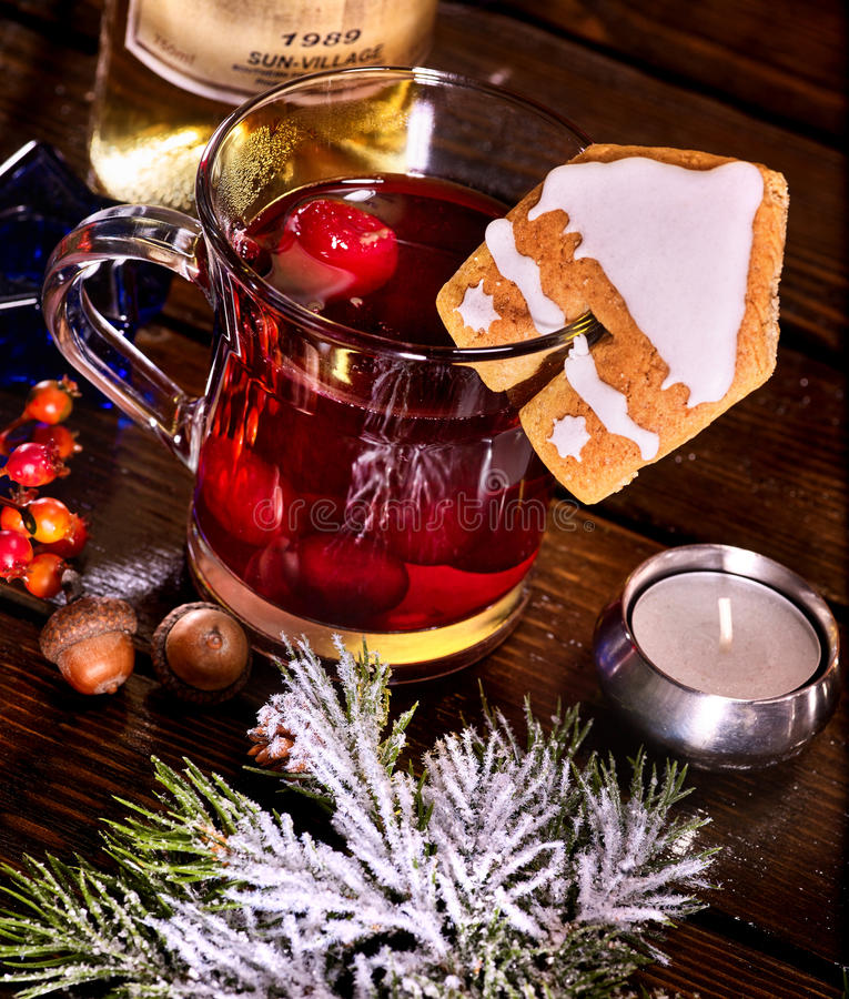 Winter hot drink with cookie and spruce branch. Top view. Still life of winter hot drink mulled and spruce branch. Warming mulled wine with cookie in form of royalty free stock photo