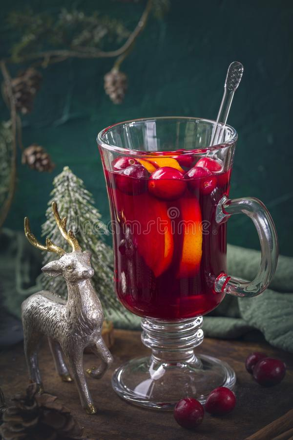 Winter hot drink with oranges. And cranberries royalty free stock images