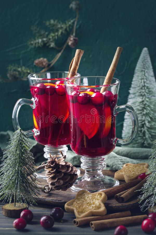 Winter hot drink with oranges. And cranberries royalty free stock photography