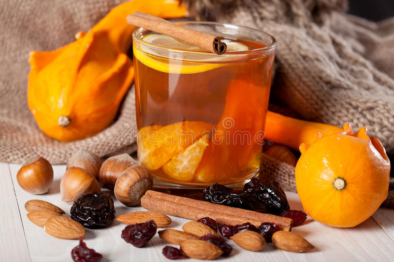 Winter hot drink with oranges royalty free stock photography