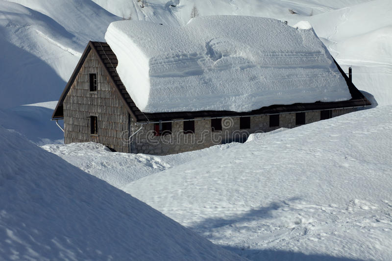 Winter house covered with snow stock image