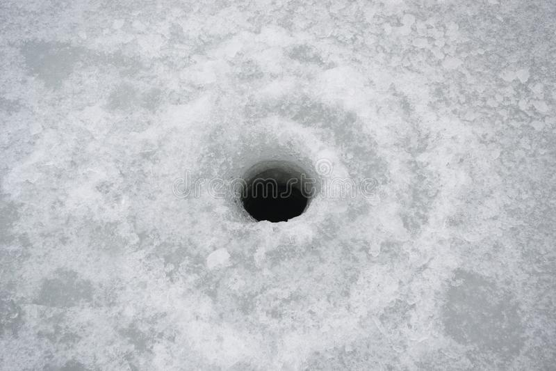 Winter ice fishing hole royalty free stock images