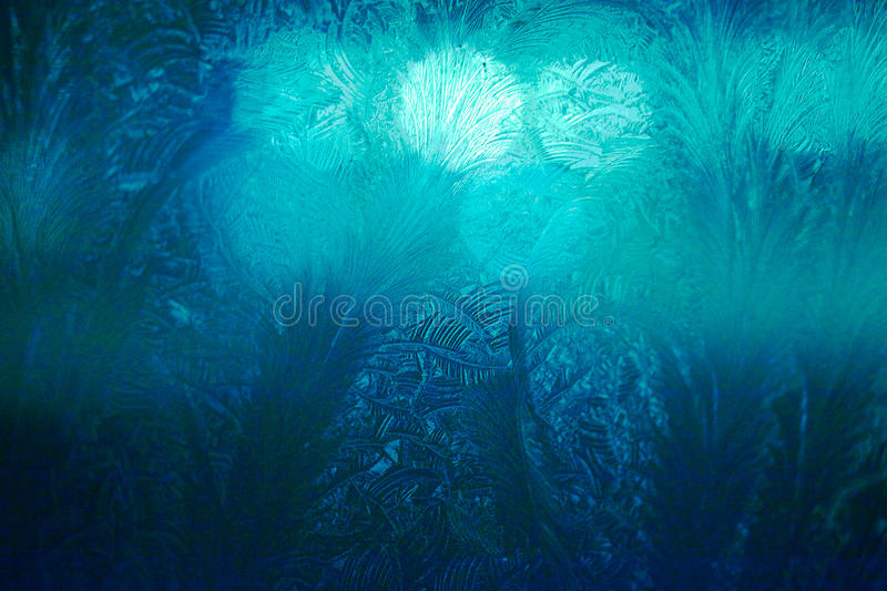 Winter ice frost, frozen background. frosted window glass texture. Cold cool icicles background. Winter wonderland scene. stock images