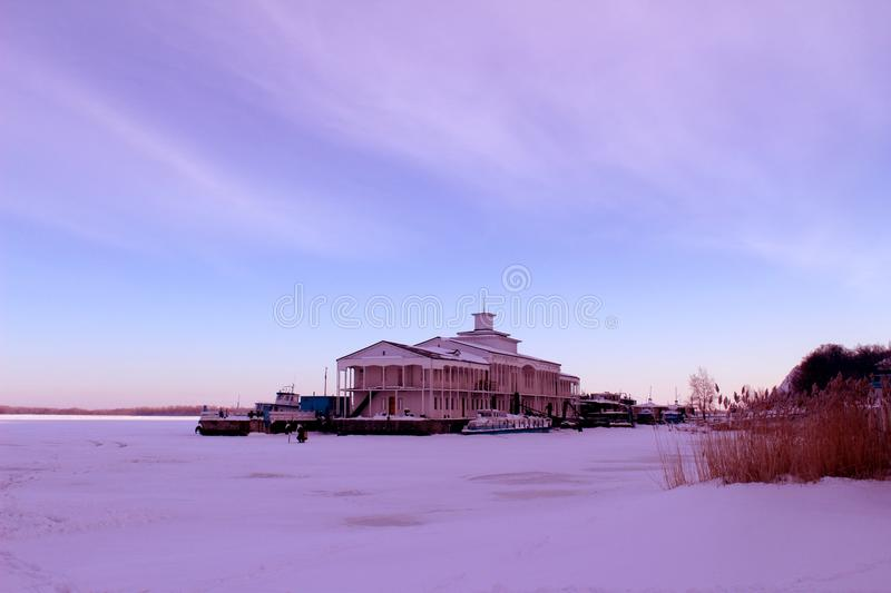 Winter ice frost hoar cold freezing january sky snow pier dock stock image