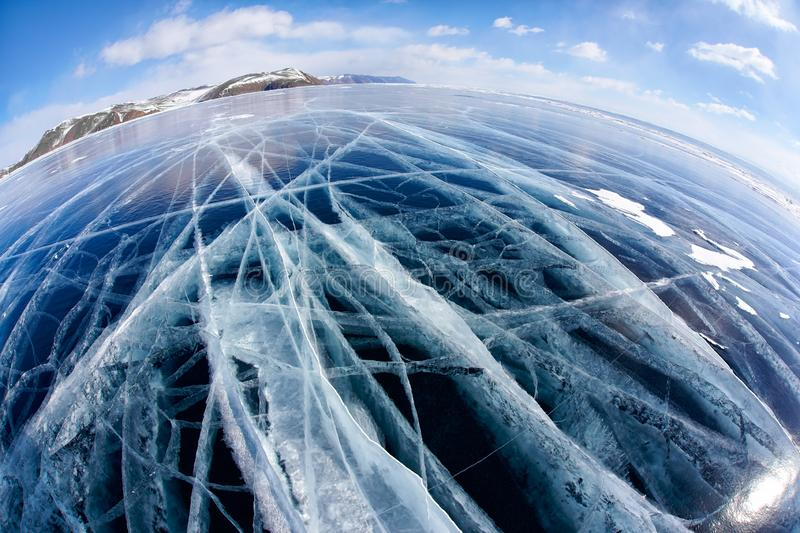 Winter ice landscape on Siberian lake Baikal with clouds. Wide angle shot with fisheye lens of winter ice landscape on Siberian lake Baikal with dramatic weather stock images