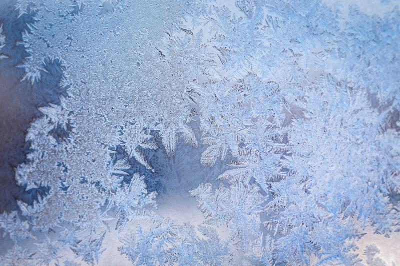 Winter ice pattern on the frozen window. Texture, background for inserting text. New Year theme. Winter. Cold stock image