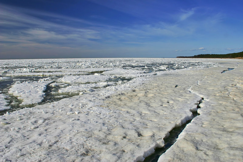 Winter ice sea. Landscape with winter sea covered by white ice stock photos