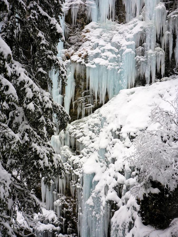 Winter ice and snow wonderland in wild nature in the Alps stock photos