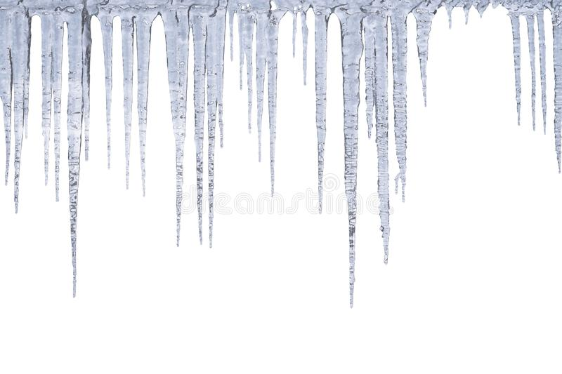 Winter icicles hang from top, isolated on white stock images