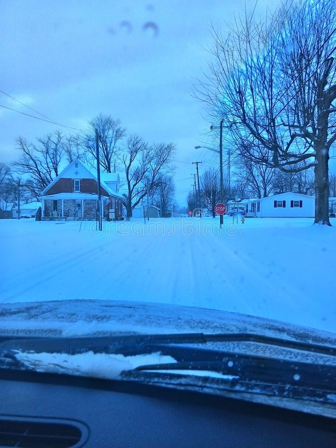 Winter in Indiana. Driving in an Indiana town while snowing royalty free stock photo