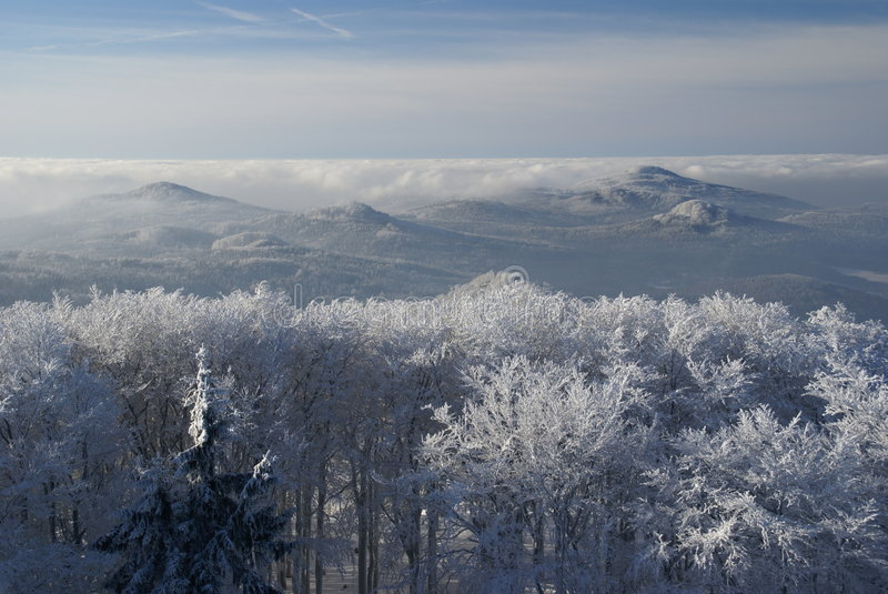 Winter inversion. And low lying clouds in snow covered hilly country royalty free stock image