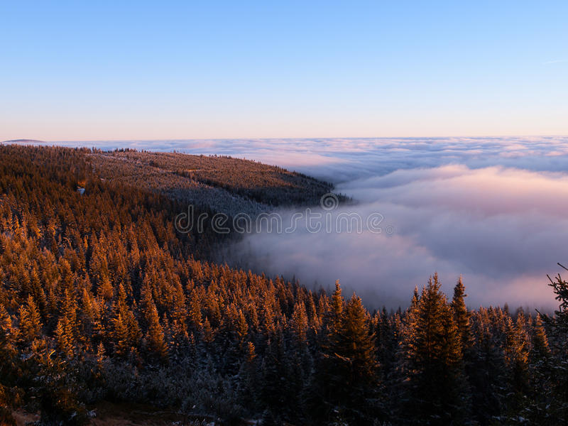 Winter inversion. Clouds in the mounains at sunset time stock photos