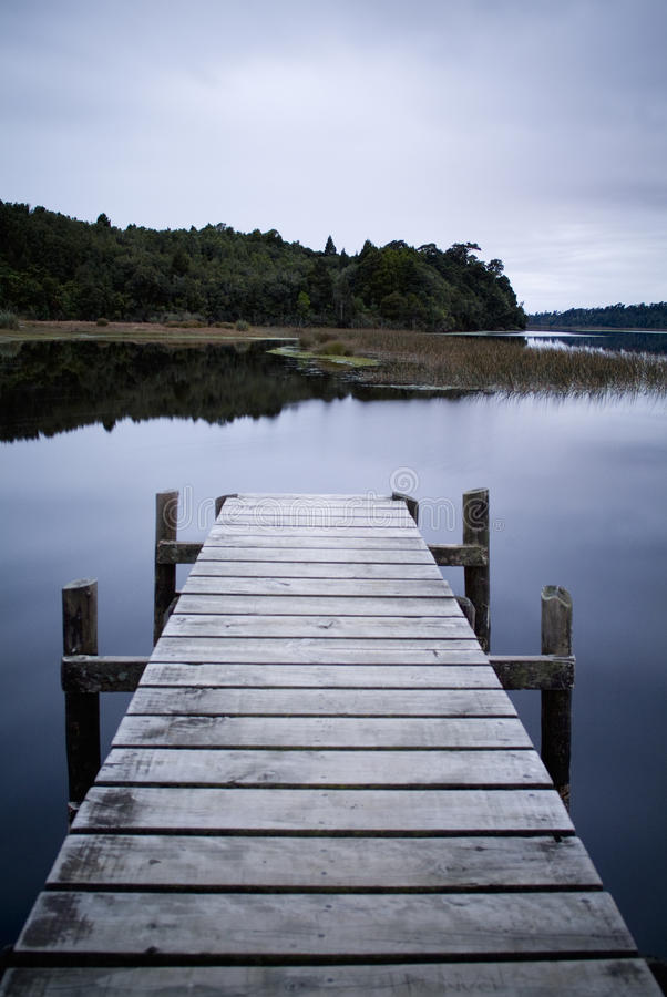 Winter Jetty. Empty and serene jetty on a moody winters day royalty free stock images