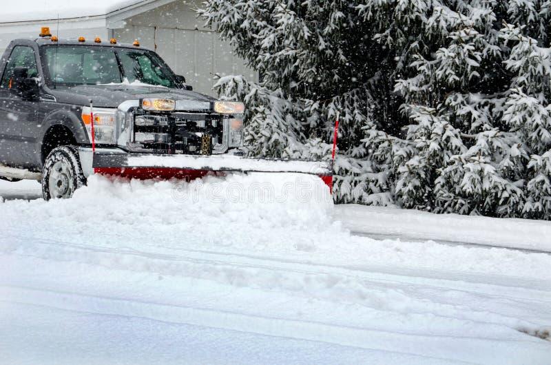 Winter job plowing snow royalty free stock photo