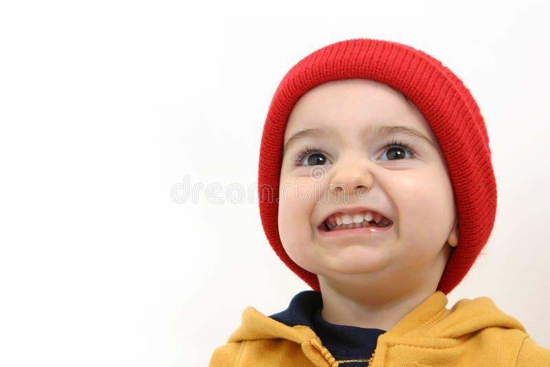 Winter-Jungen-Kind mit großem Lächeln lizenzfreie stockfotos