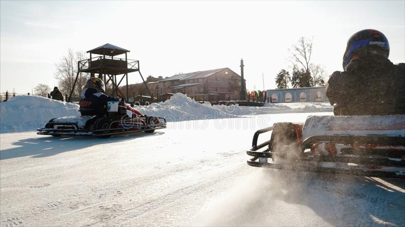 Winter karting competition on the ice track. Clip. Motion of go kart race in winter royalty free stock photo