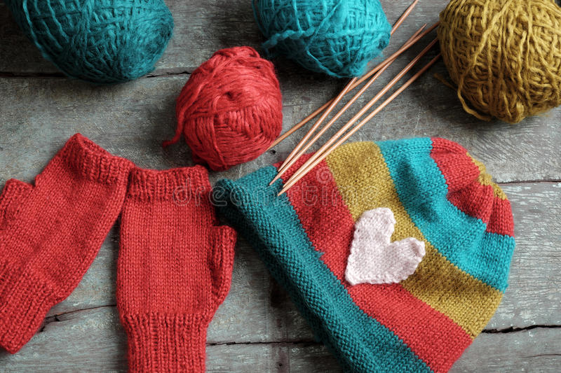 Winter, knitted gloves, knit hat. Handmade gift for winter, knitted gloves and knit hat for cold day, group of colorful yarn make warm, knit accessories is hobby royalty free stock photography