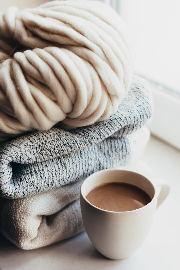 Winter knitting by the window stock images